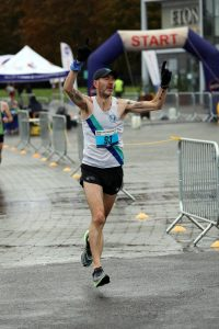 Man running celebrating completing marathon